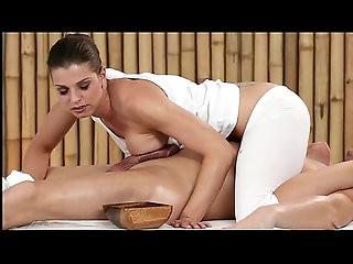 Brunette masseuse oiled fucking customer on a table