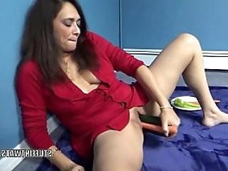 Mature brunette Alesia Pleasure with her veggies