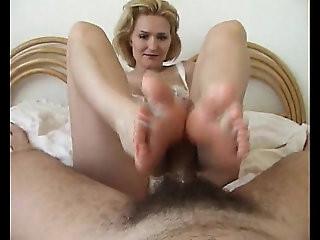 Monique Milks a Cock With Oiled Feet