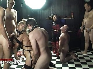 Lady A.J. plays with the slave Sandy and slaves
