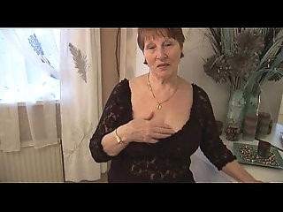 Hairy granny in crotchless panties posing